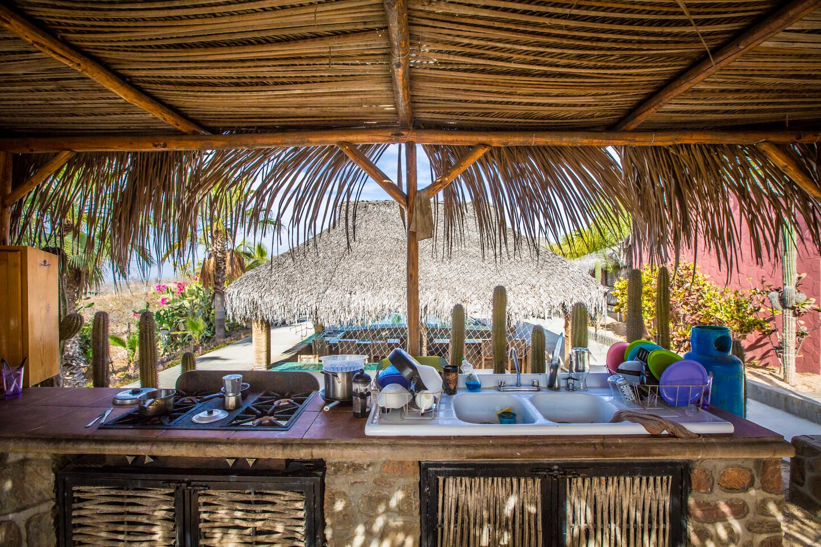 Open air kitchen at the surf camp goes right along with the BYOB and bartender swim-up pool bar.