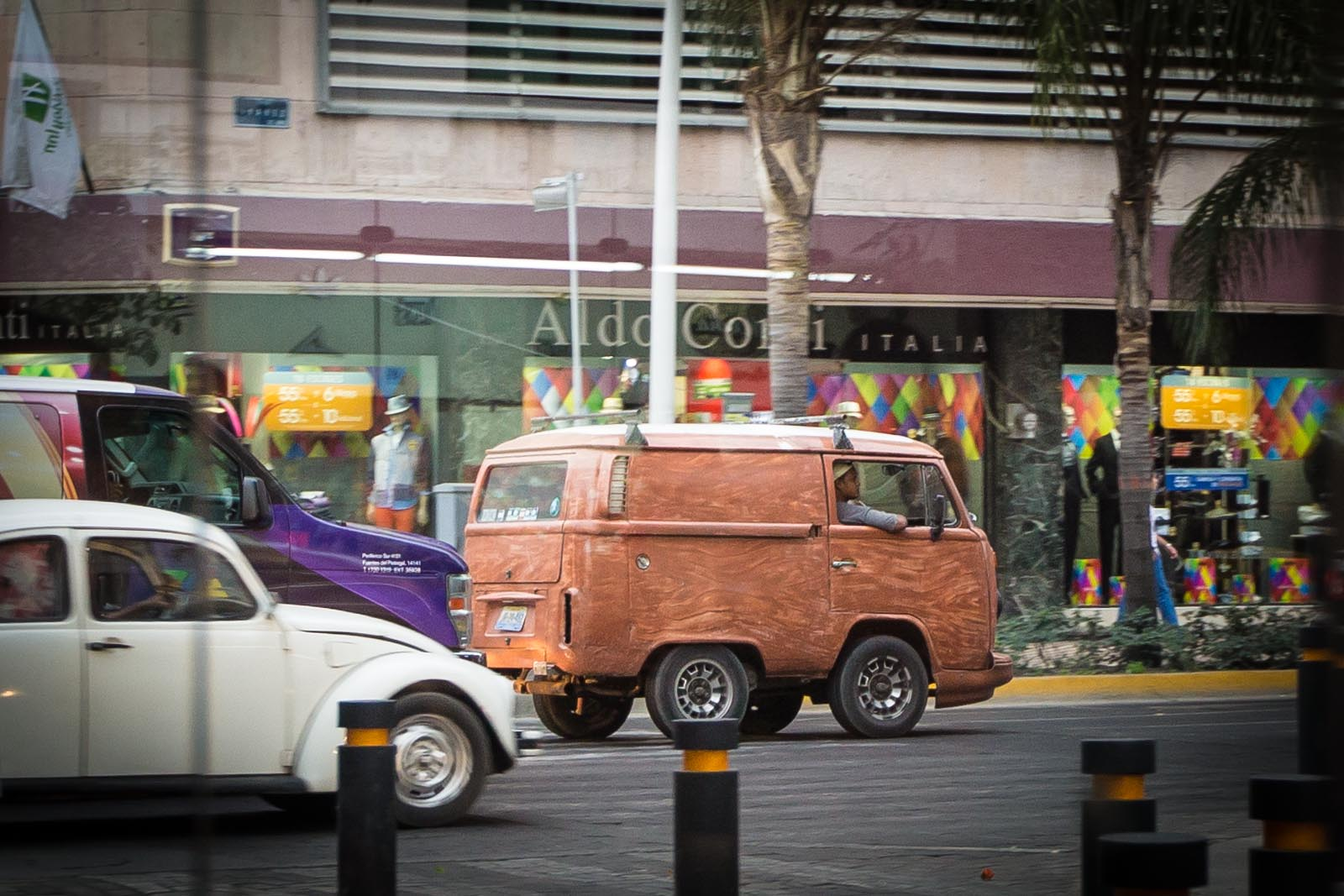 I LOVE THIS SO MUCH. A fake woody VW Bus on a golf cart chasis?
