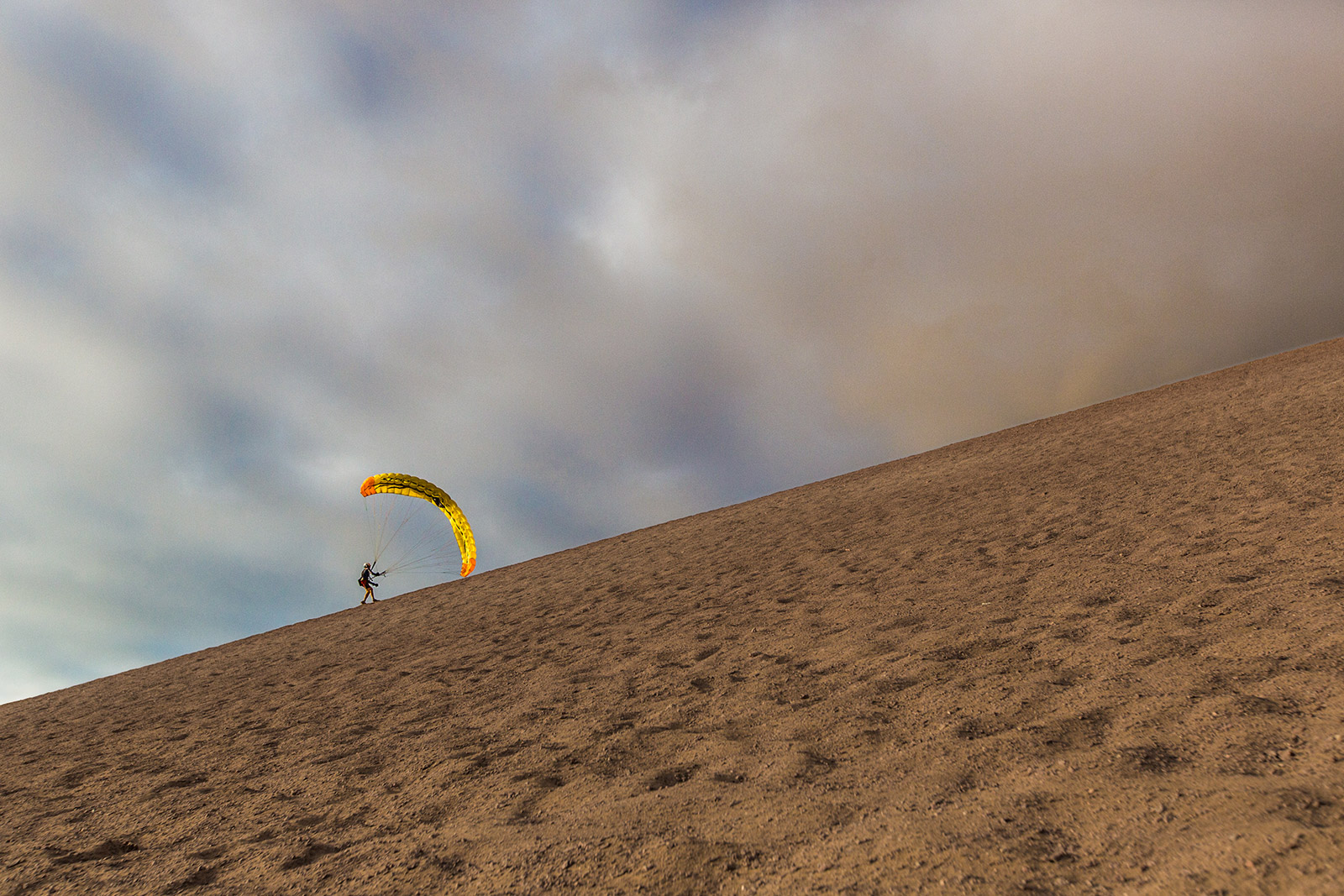 Chris working his way up the dune for a sunset swoop.